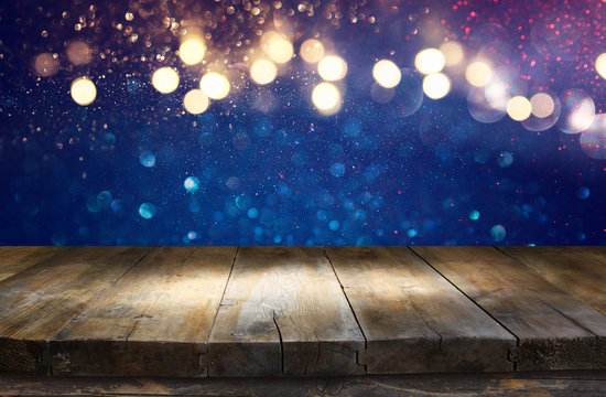 Empty table in front of blue glitter lights background