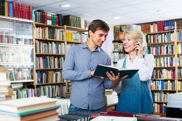 woman and man with books and phone