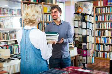 woman and man with books in shop