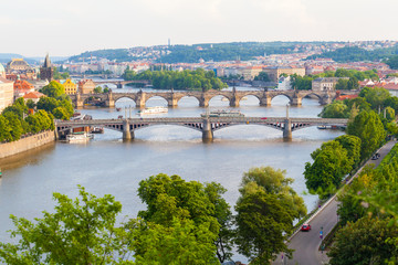 Wall Murals Prague Panorama of the old part of Prague from the Letna park. Beautiful view on the bridges over the river Vltava at sunset. Old Town architecture, Czech Republic.