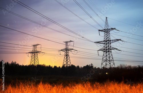 """High voltage power tower and silhouette power lines ..."