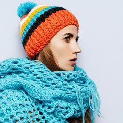 Brunette girl Pom pom hat and knitted scarf. Warm fashion access