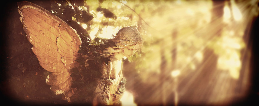 golden angel in the sunlight (antique statue) (retro styled)