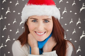 Portrait of smiling woman in santa hat