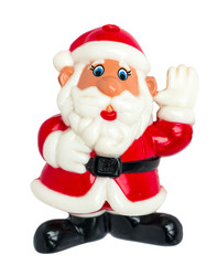Toy Santa on a white background waving hand. Santa isolated on white.