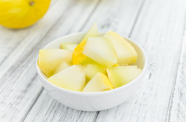 Portion of Yellow Honeydew Melon on wooden background (selective