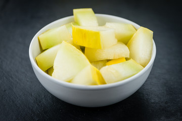 Honeydew Melon on a slate slab (selective focus)