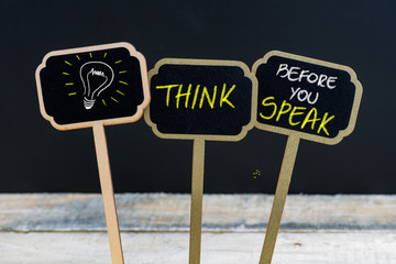 Concept message THINK BEFORE YOU SPEAK and light bulb as symbol for idea