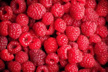 Fresh raspberries fruit closeup background