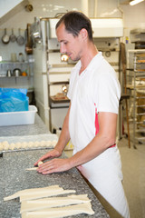 Pastry chef in a bakery making cakes