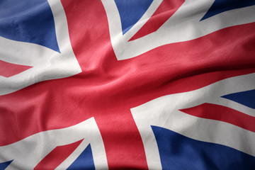 waving colorful flag of great britain. Fototapete