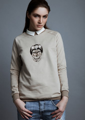 Beautiful fashion model wearing grey jumper scull