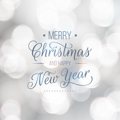 Merry Christmas and Happy New Year greeting card. Modern calligraphy lettering. Typographic vector design, beautiful light bokeh background, blurred festive lights.