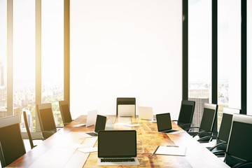 Laptops on conference table