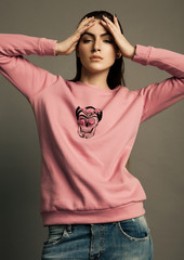 Beautiful fashion model wearing pink jumper scull