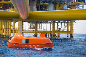 Life boat or survival craft while annual testing to escape at offshore oil and gas central processing platform