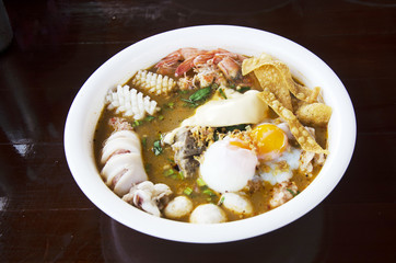 noodles tom yam soup thai style with pork and seafood and soft-b