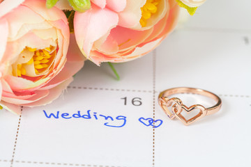 Wedding note on a calendar sets a reminder for the wedding