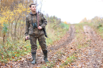 man hunter outdoor in autumn hunting