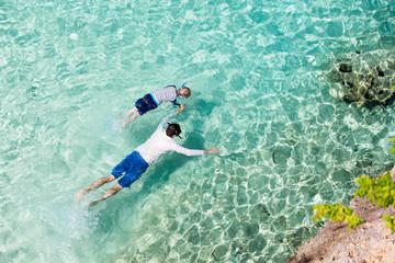 family snorkeling at caribbean