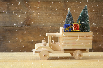 Wooden car carrying a christmas tree