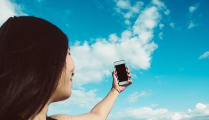 Women asian take selfie with smartphone in summer blue sky