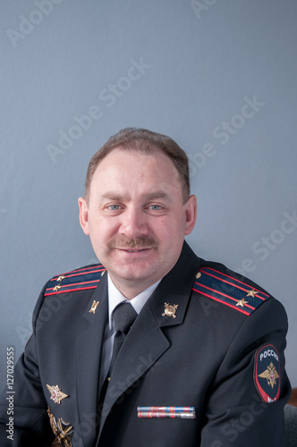 Smile  Portrait of a man with a mustache in a police uniform