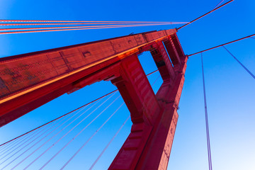 Low Angle Red Golden Gate Bridge Tower Blue Sky