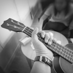 Hand holding ukulele