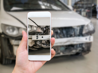 woman holding smartphone and take photo of car accident