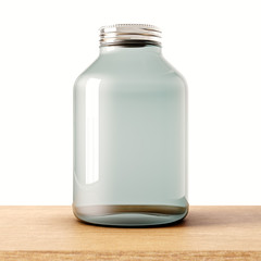 One empty jar of transparent glass with closed metal cap on the wood desk.White wall at background.Clean glassy container. Drinks,food storage concept.3d rendering.