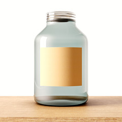 One empty jar of transparent glass with closed metal cap on the wood desk.White wall at background.Clean glassy container and craft mockup label.Drinks,food storage concept.3d rendering.