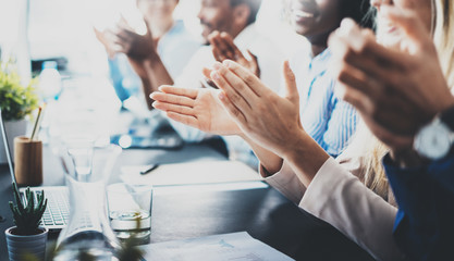 Close up view of business seminar listeners clapping hands. Professional education, work meeting, presentation or coaching concept.Horizontal,blurred background.