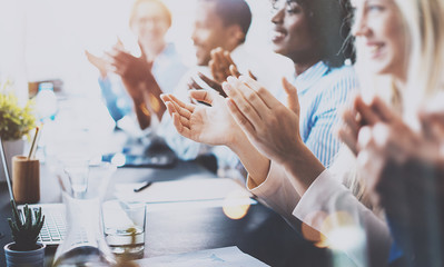 Photo of partners clapping hands after business seminar. Professional education, work meeting, presentation or coaching concept.Horizontal,blurred background.