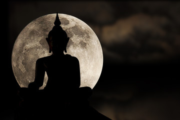 Silhouettes of buddha statue and super moon, Full moon