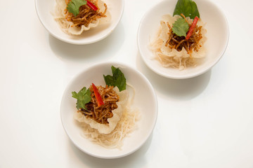 thai  appetizer presented on  small cup and garnish.