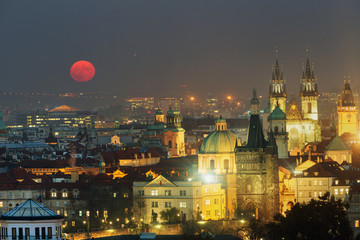 Full moon in Prague Old Town panoramic photo view. Towers of Church of Our Lady before Tyn, Prague, Czech Republic