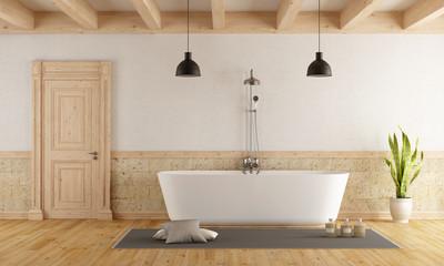 Modern bathtub in a rustic room