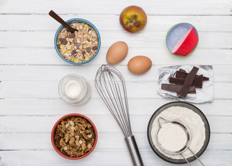 Ingredients for baking cake .Flour, sugar, butter, oats, eggs, chocolate  walnuts