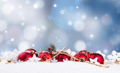 Christmas decoration in snow background with free space. Celebration balls and other decoration. Christmas concept