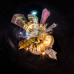 Miniature tiny planet of Night skyline of Warsaw with soviet era Palace of Culture and science and modern skyscrapers. 360 degree montage from 20 images