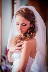 Wedding bride. Portrait of beautiful bride at the wedding morning, preparation of elegant bride