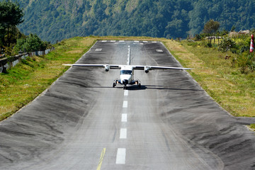 The aircraft on the runway of the Tenzing-Hillary airport Lukla - Nepal, Himalayas.