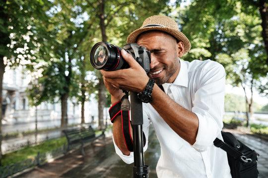 Smiling black man in park