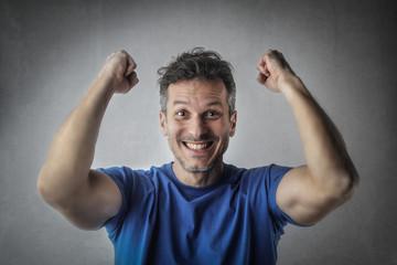 Muscular man exulting