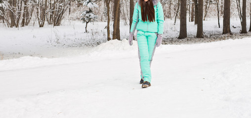 woman walk in the winter snowy scenery