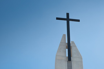 Black cross.