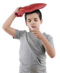 Sick boy checking his fever isolated on white background