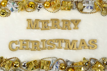 Merry christmas golden text and Christmas decorations on a white