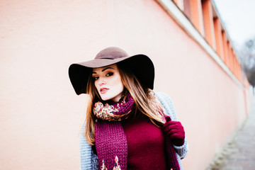 Outdoor portrait of sensual stylish lady in hat. Autumn woman.